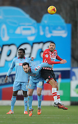 Exeter City's Liam Sercombe challenges for the header with Tranmere Rovers's Lee Molyneux - Photo mandatory by-line: Dougie Allward/JMP - Mobile: 07966 386802 - 31/01/2015 - SPORT - Football - Exeter - St James Park - Exeter City v Tranmere Rovers - Sky Bet League Two