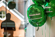 A student employee with the Department of Housing and Residence Life prepares balloons for the Ohio University Residential Housing Phase 1 opening ceremony and ribbon cutting event on Saturday, August 29, 2015 at the Living Learning Center on the Ohio University campus in Athens, Ohio.