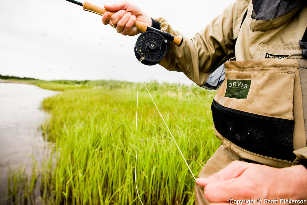 Anders Gustafson fly fishing for salmon on the Mulchatna River in Bristol Bay, Alaska.