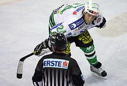 Tomaz Vnuk of ZM Olimpija and referee at ice hockey matchZM Olimpija vs Liwest Linz in second round of semi-final of Ebel League (Erste Bank Eishockey Liga),  on February 28, 2008 in Arena Tivoli, Ljubljana, Slovenia. Win of ZM Olimpija 3:2. (Photo by Vid Ponikvar / Sportal Images)