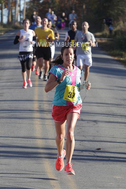 Goshen, New York  - Runners race in the Hambletonian Marathon on Sunday, Oct. 20, 2013.