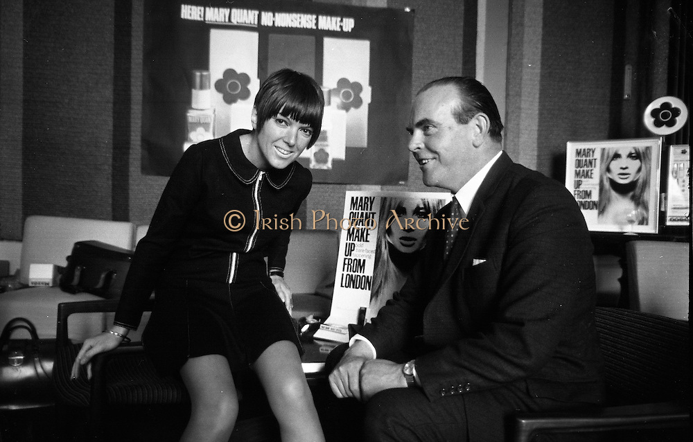 Mary Quant introduced her range of cosmetics at a press conference at the Royal Yacht Club, Dun Laoghaire. Picture shows Mary Quant with Mr. Liam Minihan of Oliver Plunkett Street, Cork, stockist of the cosmetics..24.04.1967