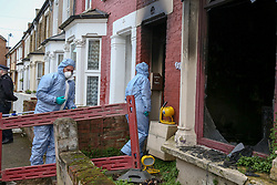© Licensed to London News Pictures. 10/02/2020. London, UK. Forensic officers enter a property on Olinda Road, in Hackney, North London following a fire where a woman died. Police were called to Olinda Road at around midnight. According to the neighbours, the woman was in her 70s. Photo credit: Dinendra Haria/LNP