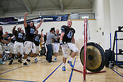 09/20/2014 - Somerville, Mass. - Tufts LB Tommy Meade, A15, leads the seniors in banging a ceremonial gong, a new tradition implemented this year for every win, in Tufts' 24-17 win over Hamilton at Zimman Field on Sept. 20, 2014. The win snapped a 31-game losing streak. (Kelvin Ma/Tufts University)