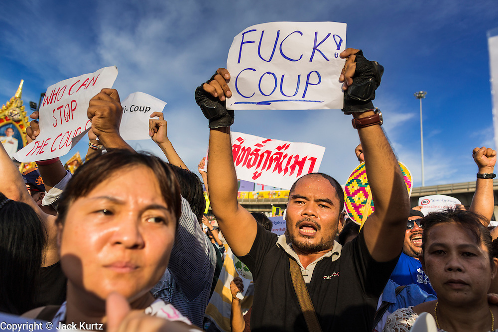 24 MAY 2014 - BANGKOK, THAILAND: Thai anti-coup / pro-democracy protestors march around Victory Monument in Bangkok. There were several marches in different parts of Bangkok to protest the coup that unseated the popularly elected government. Soldiers and police confronted protestors and made several arrests but most of the protests were peaceful. The military junta also announced that firing of several police commanders and dissolution of the Thai Senate. The junta also changed its name from National Peace and Order Maintaining Council (NPOMC) to the National Council for Peace and Order (NCPO).   PHOTO BY JACK KURTZ