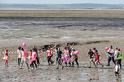 A charity fun run across the muddy foreshore at Leigh on Sea. Essex UK June 2007