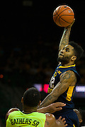 WACO, TX - MARCH 5: Tarik Phillip #12 of the West Virginia Mountaineers drives to the basket against the Baylor Bears on March 5, 2016 at the Ferrell Center in Waco, Texas.  (Photo by Cooper Neill/Getty Images) *** Local Caption *** Tarik Phillip