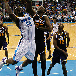 April 11, 2011; New Orleans, LA, USA; New Orleans Hornets center Emeka Okafor (50) has a shot blocked by Utah Jazz center Al Jefferson (25) during the first half at the New Orleans Arena.  Mandatory Credit: Derick E. Hingle