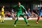 Scunthorpe United goalkeeper Jak Alnwick (25) celebrates his penalty save during the EFL Sky Bet League 1 match between Scunthorpe United and AFC Wimbledon at Glanford Park, Scunthorpe, England on 30 March 2019.