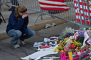 Jillian Blenis, of Boston, MA reacts as she visits a makeshift memorial for the victims of Monday's terrorist bombings at the Boston Marathon, on Boylston St. in Boston, MA on Wednesday, April 17, 2013. (Matthew Cavanaugh for The Washington Post)