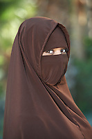 Portarit of young woman in brown niqab