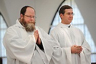 Benedictines Brother Francis Hein (left) and Brother Cassian Koenemann pause during the Mass of Ordination to the Diaconate where they became transitional Deacons at the Church of the Abbey of Saint Mary and Saint Louis in Creve Coeur, Mo. Saturday, Aug. 11, 2012. Presiding was The Most Rev. Robert J. Carlson, Archbishop of St. Louis. Photo © copyright 2012 Sid Hastings.