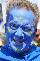 "© Licensed to London News Pictures. 20/07/2019. London, UK. A protester is seen with his face painted in the colours of the EU flag as Pro EU demonstrators take part in the ""No to Boris. Yes to Europe"" march in central London. Photo credit: Dinendra Haria/LNP"