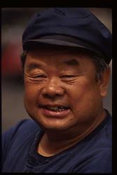 Beijing, China - Chinese Laborer in Mao cap. (Photo © Jock Fistick)