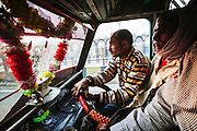Passangers traveling in the city in an auto rickshaw in Lucknow, Uttar Pradesh, India