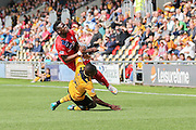 \nc25\ fouls York City defender David Tutonga on loan from Cardiff City during the Sky Bet League 2 match between Newport County and York City at Rodney Parade, Newport, Wales on 5 September 2015. Photo by Simon Davies.