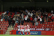 Luke Varney scores Cheltenham's 2nd goal and celebrates with the fans   during the EFL Sky Bet League 2 match between Cheltenham Town and Carlisle United at Jonny Rocks Stadium, Cheltenham, England on 20 August 2019.