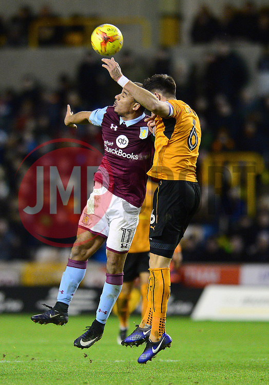 Gabriel Agbonlahor of Aston Villa challenges for a header with  Danny Batth of Wolverhampton Wanderers - Mandatory by-line: Dougie Allward/JMP - 14/01/2017 - FOOTBALL - Molineux - Wolverhampton, England - Wolverhampton Wanderers v Aston Villa - Sky Bet Championship