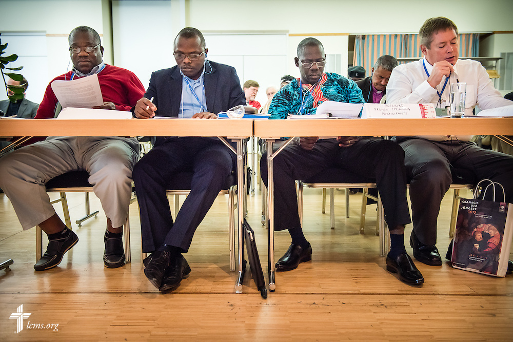 The Rev. Frederick Reinhardt (right), the LCMS area facilitator for French-speaking Central and East Africa, translates for West African church leaders on Thursday, May 7, 2015,  at the International Conference on Confessional Leadership in the 21st Century in Wittenberg, Germany. LCMS Communications/Erik M. Lunsford