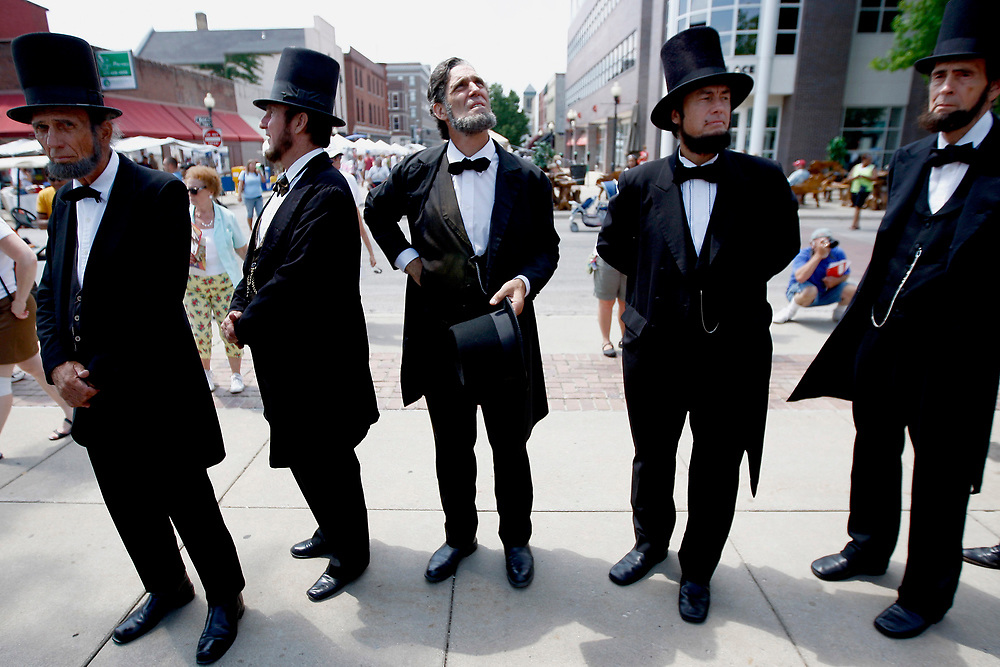 HONEST ABES -- Five of the 12 Abraham Lincoln presenters (from l-r) James Conine, Max Daniels, Randy Duncan, Larry Elliott and John Mansfield look around at Central Park before taking the stage for the start of the National Abraham Lincoln Look Alike Competition during Decatur Celebration Saturday, Aug. 8, 2009, in Decatur, Ill.