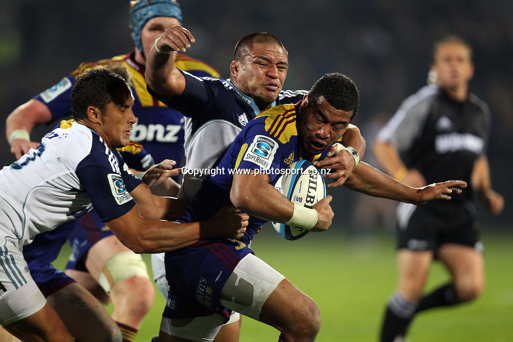 Siale Piutau is tackled by Keven Mealamu.<br /> Investec Super Rugby - Highlanders v Blues, 29 April 2011, Carisbrook Stadium, Dunedin, New Zealand.<br /> Photo: Rob Jefferies / www.photosport.co.nz