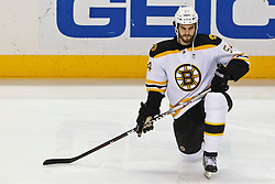 Mar 22, 2012; San Jose, CA, USA; Boston Bruins defenseman Adam McQuaid (54) warms up before the game against the San Jose Sharks  at HP Pavilion. San Jose defeated Boston 2-1. Mandatory Credit: Jason O. Watson-US PRESSWIRE