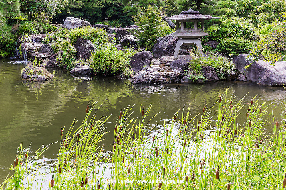 Pond Garden at Naritasan Shinshoji Garden - Naritasan Shinshoji is one of the most important Buddhist temples in the Tokyo area, and the Head of the Chisan Shingon Buddhism sect.  Its Japanese garden, usually called Naritasan Park,is composed of wooded and landscaped greenery. Stone monuments and memorials bearing haiku poetry punctuate the landscape, making it one of the most unusual Japanese gardens in the country. Its centerpiece is a pond with a pagoda in the middle.  In addition there is a waterfall composed with a surrounding rock garden.