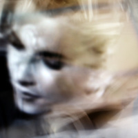blurred dream image of a young woman looking down