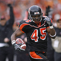 Oregon State's Derrick Doggett returns an interception  34 yards for a touchdown, putting the Beavers up 17-7 in the second quarter of the Civil War at Reser Stadium on Friday Nov. 24, 2006. Photo by Timothy J. Gonzalez