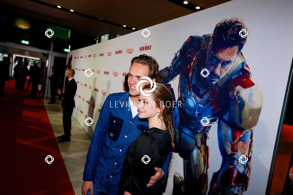 AMSTERDAM - In het Rai theater is de filmpremiere van Iron Man 3. Met op de foto  Pim Wessels met partner Pip Pellens. FOTO LEVIN DEN BOER - PERSFOTO.NU