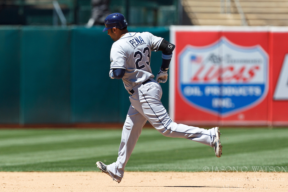 OAKLAND, CA - AUGUST 01: Carlos Pena #23 of the Tampa Bay Rays rounds the bases after hitting a home run against the Oakland Athletics during the eighth inning at O.co Coliseum on August 1, 2012 in Oakland, California. The Tampa Bay Rays defeated the Oakland Athletics 4-1. (Photo by Jason O. Watson/Getty Images) *** Local Caption *** Carlos Pena