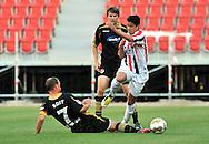05-08-2008 Voetbal:FC ENERGIE COTTBUS:WILEM II:COTTBUS<br /> Veloso ontwijkt de sliding van Timo Rost<br /> <br /> Foto: Geert van Erven
