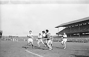 Galway players attempts a tackle during the All Ireland Minor Gaelic football final Derry v. Kerry in Croke park on the 26th September 1965.