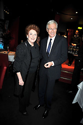 "PAUL O'GRADY and LADY ELIZABETH ANSON at a party to promote the ""American Songbook in London"" aseries of intimate concerts featuring 1959 Broadway songs, held at Pizza on The Park, Hyde Park Corner, London on 18th March 2009."
