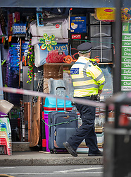 © Licensed to London News Pictures. 03/02/2020. London, UK. A policeman walks past the Low Price Store on Streatham High Road the day after a terrorist stabbed two people before being shot dead by police. Sudesh Amman, who was released from prison recently for terror offences, was under active police surveillance at the time of the attack - which police think was an Islamist-related terrorist incident. Photo credit: Peter Macdiarmid/LNP