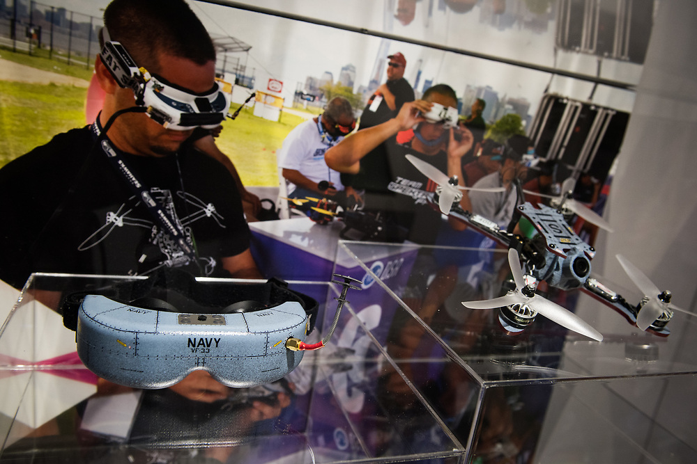 "30206010A - DRONES - A custom Navy-branded racing drone and first-person view goggles sit on display at a station talking about the new Drone Racing League at the ""Drones: Is the Sky the Limit?"" exhibit at the Intrepid Sea, Air, and Space Museum in New York, NY on May 9, 2017."