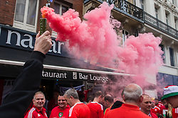 LILLE, FRANCE - Friday, July 1, 2016: A Wales fan lets off a smoke grenade in the centre of Lille ahead of the UEFA Euro 2016 Championship Quarter-Final match against Belgium at the Stade Pierre Mauroy. (Pic by Paul Greenwood/Propaganda)