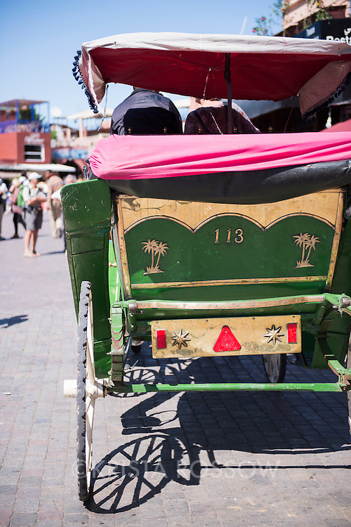 A buggy waits for customers in Jemaa el-Fnaa, the main marketplace square in the Medina of Marrakesh, Morocco.