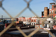 view from BUMBO with buildings roof tops and Williamsburg Bridge Brooklyn New York