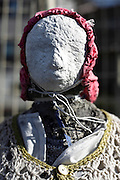 close up of an outdoors street side religious statue called Jizo Japan