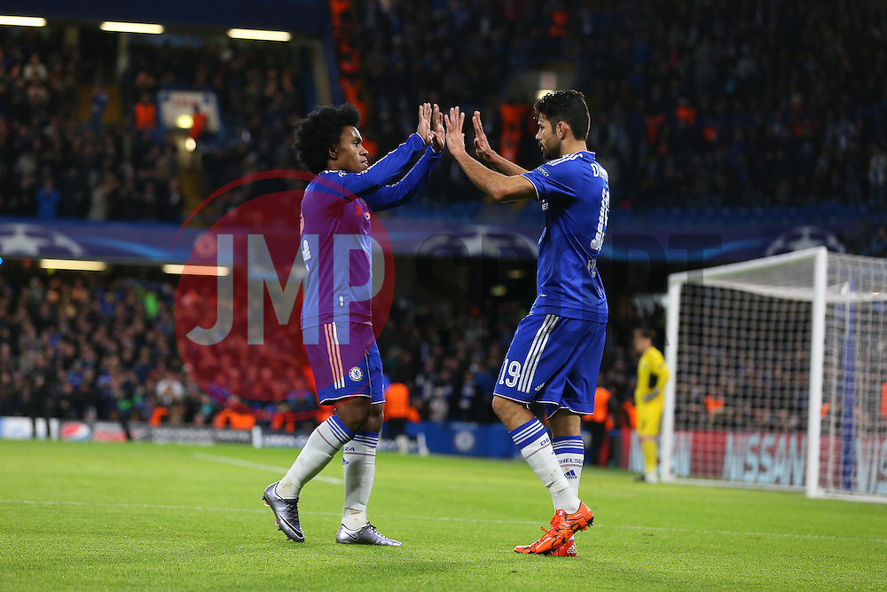 Diego Costa ( R )  of Chelsea celebrates with Willian after Ivan Marcano of FC Porto ( not pictured ) scores an own goal to make it 1-0 - Mandatory byline: Paul Terry/JMP - 09/12/2015 - Football - Stamford Bridge - London, England - Chelsea v FC Porto - Champions League - Group G