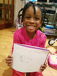 Small girl with drawing UK