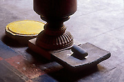 Grinding stone for turmeric at a Hindu Temple on Sea Street in Colombo.