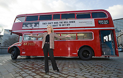 © Licensed to London News Pictures. 05/01/2012. London, UK. Actress Joanna Lumley poses for photos in front of a Routemaster bus parked on Trafalgar Square on January 5th, 2012 to unveil Compassion In World Farming's nationwide bus adverts. Part of their 2012 campaign against the long distance transport of live animals. Photo credit : Ben Cawthra/LNP