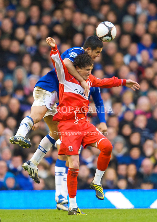 LIVERPOOL, ENGLAND - Sunday, March 8, 2009: Everton's Tim Cahill and Middlesbrough's Tuncay Sanli during the FA Cup Quarter-Final match at Goodison Park. (Photo by David Rawcliffe/Propaganda)