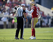 San Francisco 49ers kicker Robbie Gould (9) talks to referee Bill Vinovich (52) during an NFL football game against the Los Angeles Rams, Sunday, Oct. 13, 2019, in Los Angeles. The 49ers defeated the Rams 20-7. (Dylan Stewart/Image of Sport)