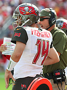 Nov 11, 2018; Tampa, FL USA: Tampa Bay Buccaneers head coach Dirk Koetter and Buccaneers quarterback Ryan Fitzpatrick (14) discuss strategy against the Washington Redskins at Raymond James Stadium. The Redskins beat the Buccaneers 16-3. (Steve Jacobson/Image of Sport)