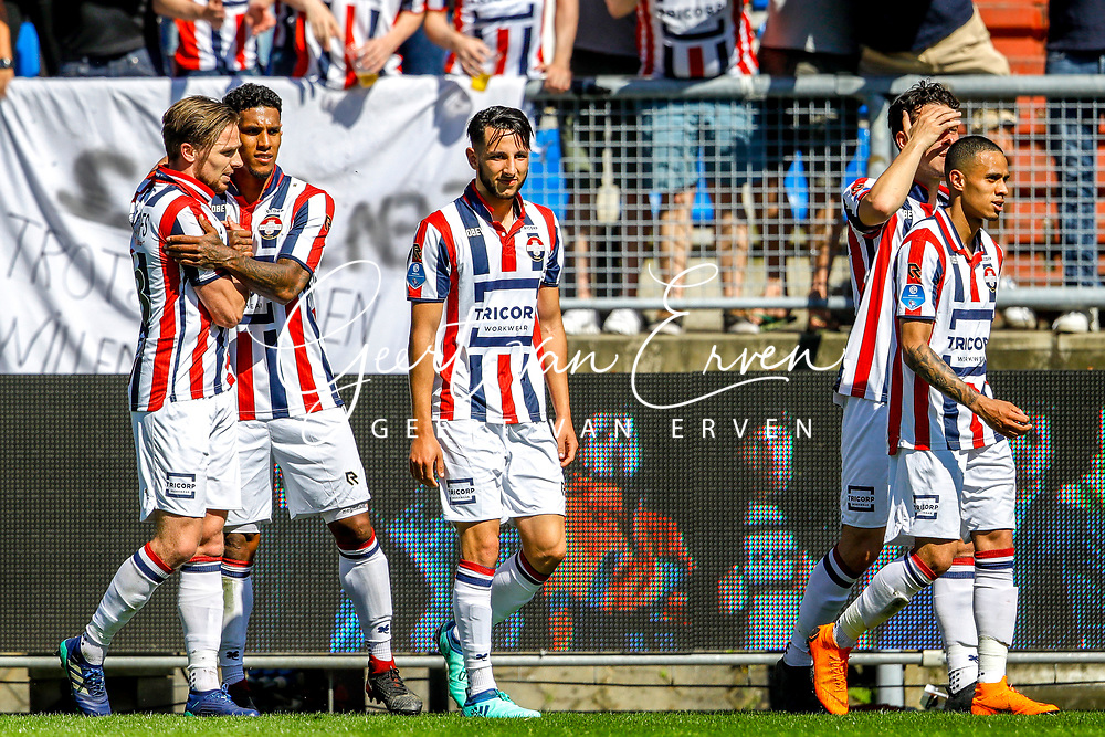 *Ben Rienstra* of Willem II celebrates 2-1 with *Darryl Lachman* of Willem II, *Ismail Azzaoui* of Willem II