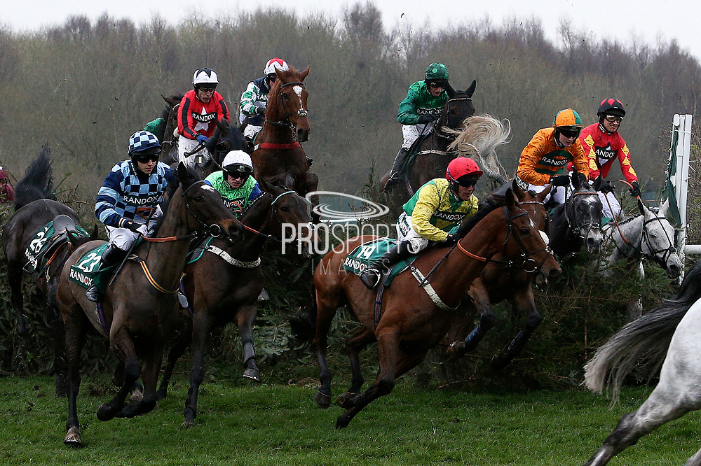 The field goes over The Canal Turn in The Randox Health Topham Handicap Steeple Chase onLadies Day at Aintree, Liverpool, United Kingdom on 13 April 2018. at Aintree, Liverpool, United Kingdom on 13 April 2018. Picture by Craig Galloway.