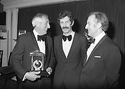 "Texaco Sportstars Of The Year Awards.1983..14.04.1983..04.14.1983..14th April 1983...Photograph of Ronnie Delaney being Congratulated by the Tanaiste,Mr Dick Spring and the Managing Director of Texaco Ireland,Mr Tony Hill,on his induction into the Sportstars ""Hall Of Fame""..Ronnie was a gold medal winner at the 1956 Summer Olympics in Melbourne,Australia. he triumphedin the 1500 metres event..."